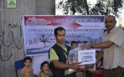 AQSA WORKING GROUP AND MI'RAJ ISLAMIC NEWS  AGENCY DISTRIBUTE AIDS TO GAZANS