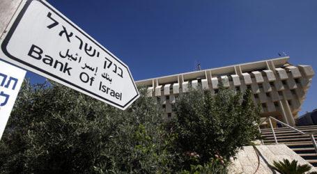ISRAEL LOWERS INTEREST RATE AS ECONOMY STRUGGLES AMID GAZA OPERATION