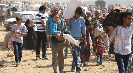 TURKEY OPENS BORDER CROSSING FOR SYRIANS ESCAPING ISIL