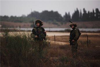 ISRAELI FORCES DETAIN 14 IN VILLAGE NEAR QALQILIYA