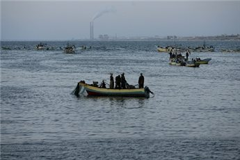 ISRAELI BOATS OPEN FIRE AT GAZA FISHERMEN