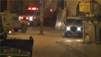 ZIONIST TROOPS RAID WEST BANK AND SHOOT TEENAGER