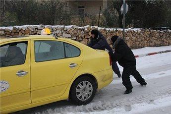 POLICE HELP 450 PEOPLE STUCK IN SNOWSTORM ACROSS WEST BANK
