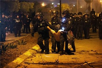 PALESTINIANS IN ISRAEL DECLARE NATIONAL STRIKE AFTER POLICE DEATHS