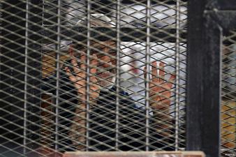 EGYPT BROTHERHOOD LEADER APPEARS IN DEATH-ROW GARB
