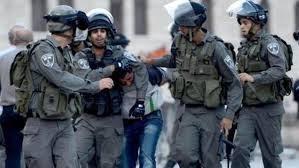 IOF ARRESTS PALESTINIAN, CLOSES ROAD IN AL-KHALIL