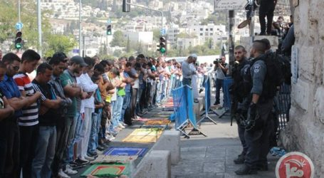 PALESTINIANS PRAY IN STREETS AMID RESTRICTIONS