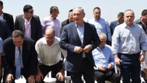 PM Benjamin Netanyahu poses for a group picture with his government at the weekly cabinet meeting, held in the Golan Heights.