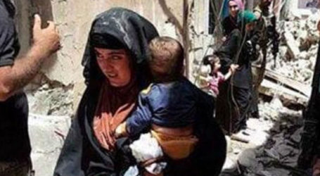Chilling Footage Captures Female Suicide Bomber Cradling Baby Moments Before She Blows Them Both Up