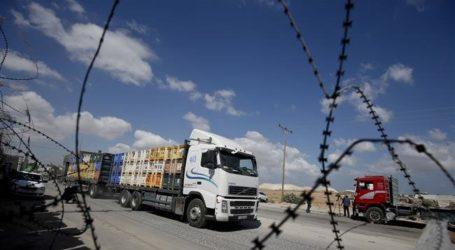 Israeli Settlers Ban Relief Trucks Crossing to Gaza