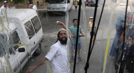 A Palestinian Injured as Israeli Settlers Stone His Vehicle